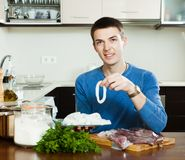 Guy cooking in home kitchen Stock Images