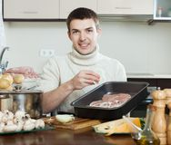 Guy cooking  meat Stock Photo