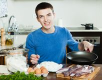 Guy cooking Stock Images