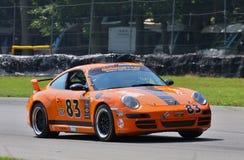 Guy Cosmo en Porsche Carrera Foto de archivo libre de regalías