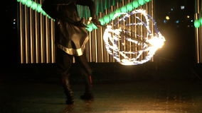 A guy in a costume quickly spinning a fireball stock video footage