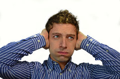 Guy covering ears with his hands. Too much noise: attractive young man covering his ears Royalty Free Stock Photos
