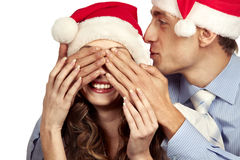 Guy covering the eyes of her girlfriend Stock Image