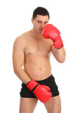 Guy covering groin with boxing glove Royalty Free Stock Photos