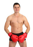 A guy covering his groin with boxing gloves Stock Photos