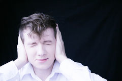 Guy covers his ears Stock Images