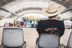 Guy with cowboy hat sitting at Rocking the Park event in Milan, Italy Royalty Free Stock Photo