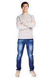 Guy with crossed arms. Full length front view portrait of smiling young man in glasses and beige sweater with crossed arms on his chest isolated on white Stock Images