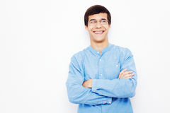 Guy with crossed arms over white Stock Images