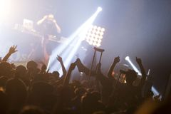 Guy in the crowd. With crutches during a show in Montreal Stock Image