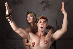 Guy with the crown on head sings his arms. Royalty Free Stock Photography