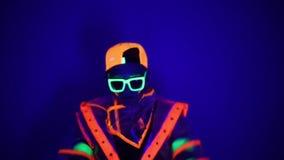 Guy dancing in neon costume stock footage