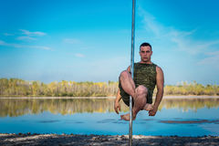 Guy dancing on a pole Royalty Free Stock Photos