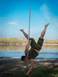 Guy dancing on a pole Stock Photo