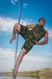 Guy dancing on a pole Stock Photos
