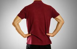 The guy in the dark red blank t-shirt Polo. Prepared for your lo. Go Royalty Free Stock Photos