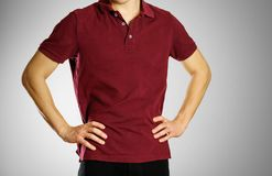 The guy in the dark red blank t-shirt Polo. Prepared for your lo. Go Royalty Free Stock Images