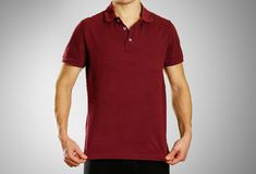 The guy in the dark red blank t-shirt Polo. Prepared for your lo. Go Stock Image