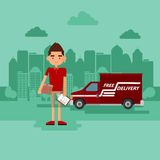 Guy delivers a parcel. The concept of delivery of parcels Stock Photo
