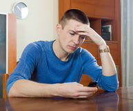 Guy  depressing  after phone call Royalty Free Stock Photography