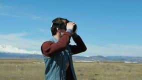 Guy in desert wearing vr glasses dissolving into pixels 20s 4k. Guy in desert wearing vr glasses dissolving into pixels. 20s 4k stock video footage