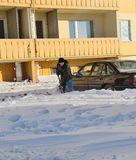 Guy digs car out of the snow Stock Photos