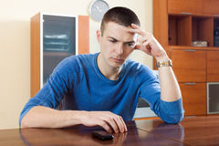 Guy  disappointment after phone call. Ordinary guy  disappointment after phone call Royalty Free Stock Image