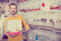 Guy  displays a purchase  in a pet shop Stock Image