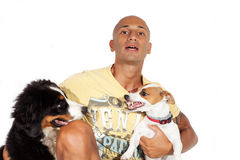Guy that divides two dogs fighting Stock Images