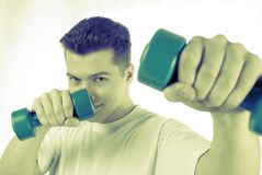 Guy does physical exercises Stock Photo