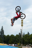 Guy does somersaults on bike Stock Photo