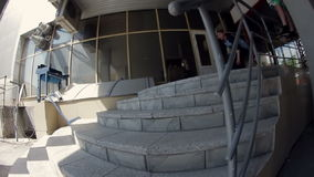 Guy does the trick with stairs on a skateboard stock video