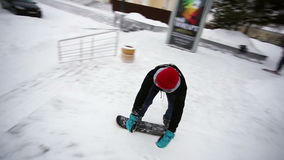 Guy does the trick from the steps on snow skate stock video