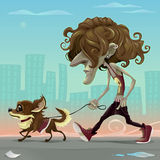 Guy with dog walking on the street Royalty Free Stock Photo