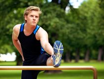 Guy Doing Exercise Routine at the Park Stock Images