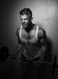 Guy doing exercises with barbell Royalty Free Stock Image