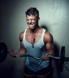 Guy doing exercises with barbell Royalty Free Stock Photography