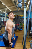 The guy is doing exercises on simulator in the gym Royalty Free Stock Photo