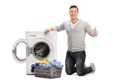 Guy doing laundry and giving thumb up Stock Photography