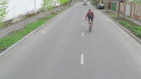 The guy doing tricks on a bicycle. Aerial survey stock video footage