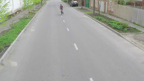 The guy doing tricks on a bicycle. Aerial survey stock video