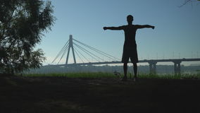Guy doing workout in the town outdoors. stock footage