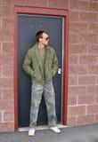 Guy in doorway. One young guy standing in a doorway looking serious stock images
