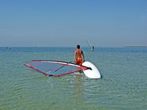 Guy drags the windsurf. The guy drags the windsurf Stock Photo