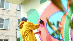 Guy drawing with paint from spray on wall. Guy drawing with colorful paint from spray on wall stock video