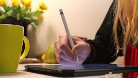 Guy draws a pen on the tablet. Guy with long hair hand draws a pen on the tablet stock video