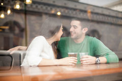 Guy drinking beer with his girlfriend at a bar Royalty Free Stock Photos