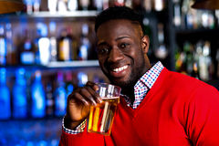 Guy drinking beer in a nightclub Stock Photo