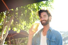 Guy drinking beer in summer at outdoor bar Stock Photography