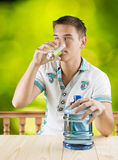 A guy drinking water from glass Stock Photo